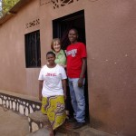 Sibomana and his sister in their new house