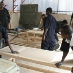 Carpentry students under the supervision of the teacher